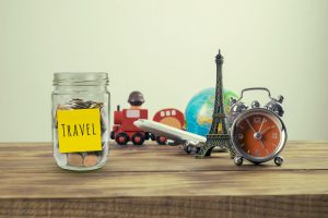 money jar with travel destinations representing affordable travel